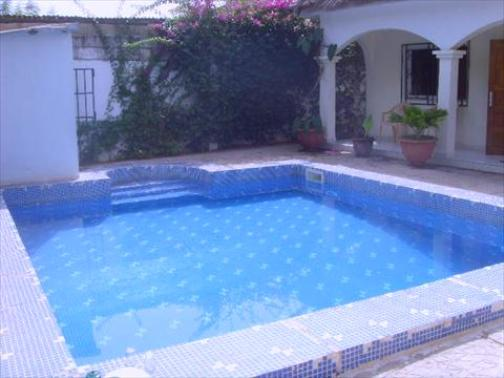 2 Bedroom Furnished Bungalow For Sale In Bijilo With Pool